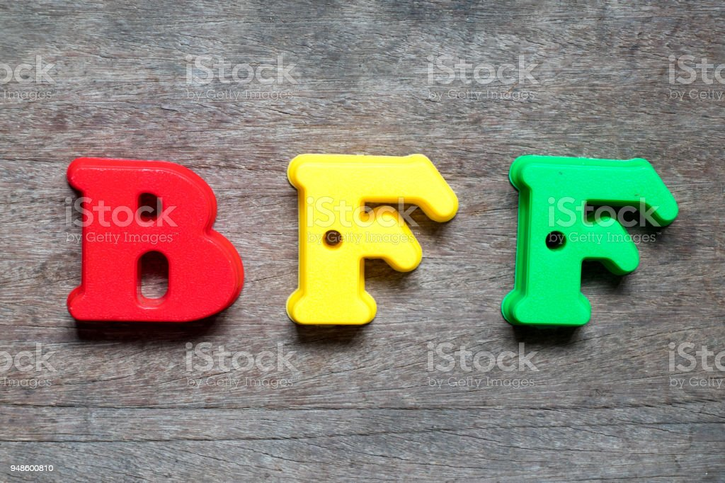 Color alphabet in word BFF (Abbreviation of best friend forever) on wood background stock photo