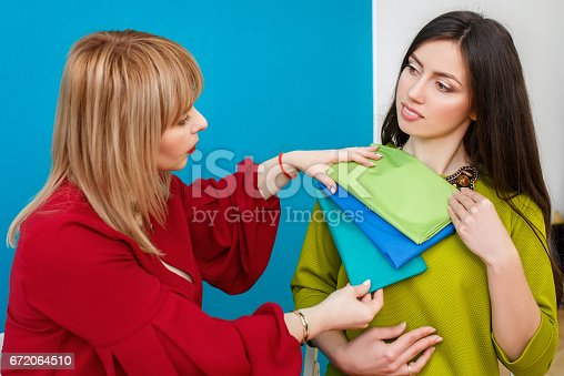 672064598istockphoto color analysis consultation for young woman 672064510