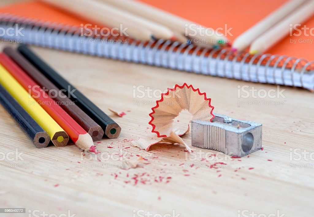 Color art pencils with sharpener and notebook royalty-free stock photo