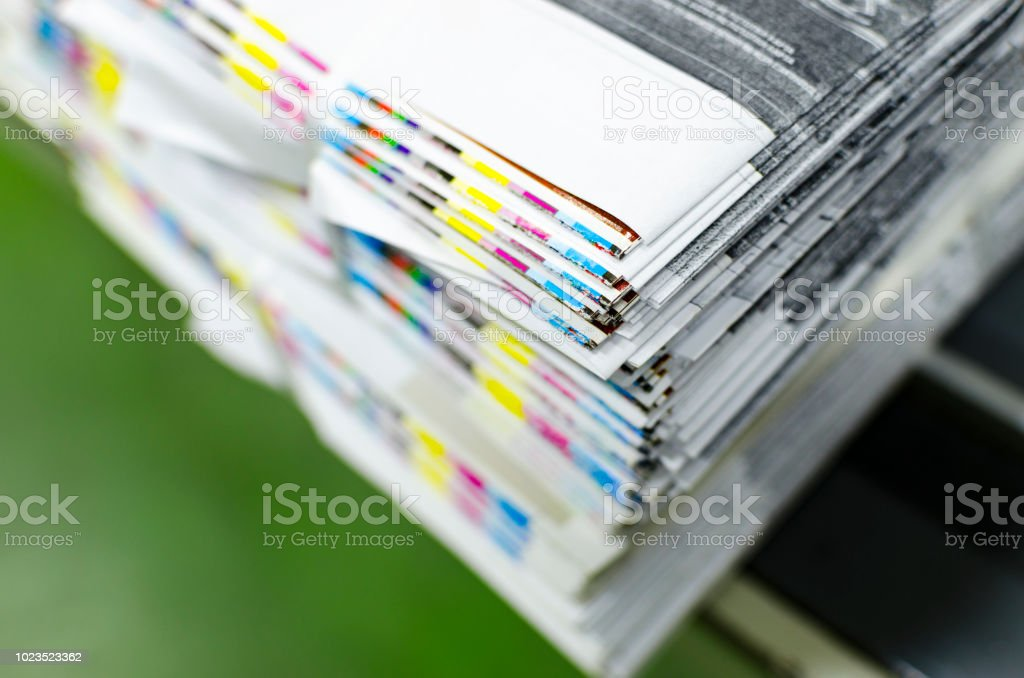 CMYK color bars on printed sheets of paper stock photo