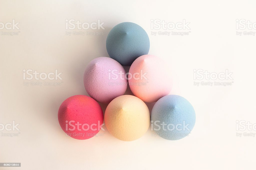 Color beauty blenders on a grey background stock photo