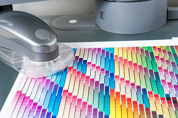 CMYK Color Chart with Spectrophotometer for Calibrating Printing Machines stock photo