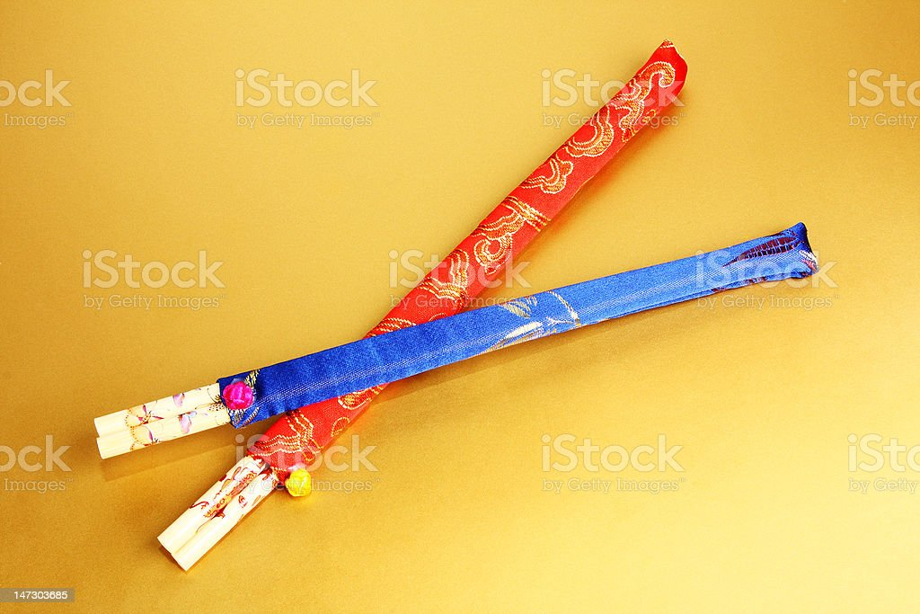 color chopsticks on gold royalty-free stock photo
