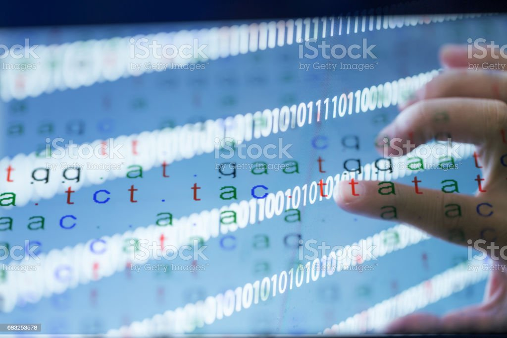 color coded DNA sequence with binary data stock photo