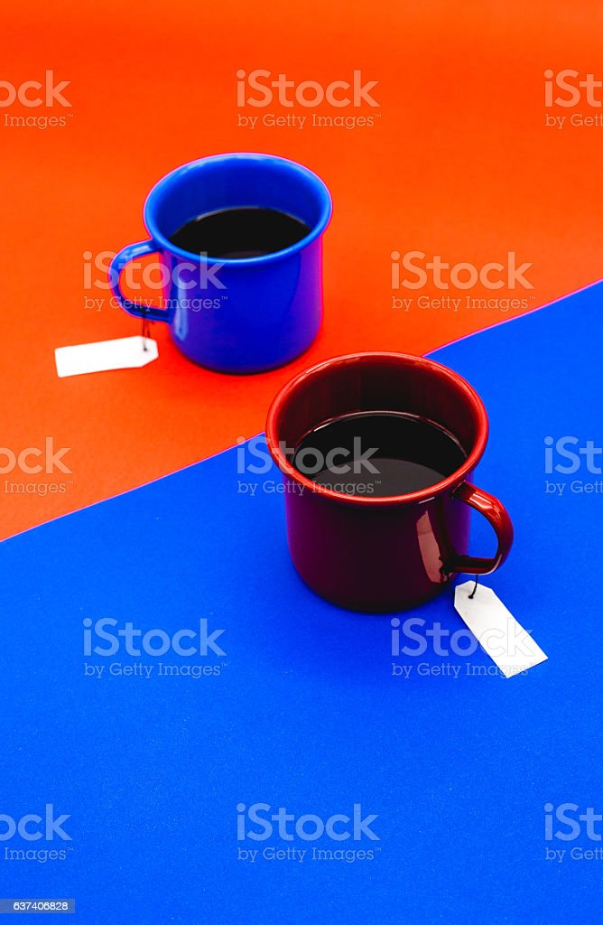 color coffee cup with blue and red bavkground stock photo