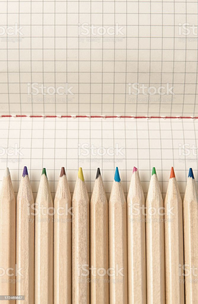 Color Crayons on graph paper royalty-free stock photo