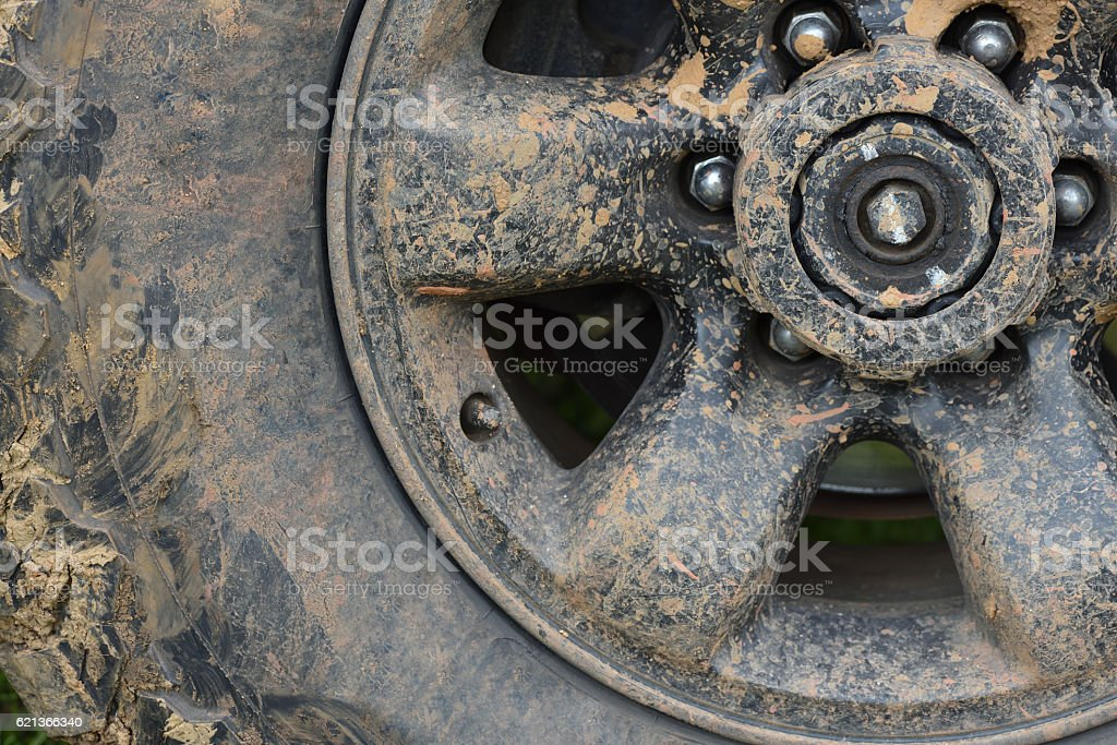 Color detail of an off-road car's wheel, covered in mud stock photo