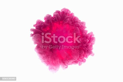 istock Color drop in water, photographed in motion. Abstract swirling. Cloud of silky bulb under water isolated on white background. Pink paint 936338990