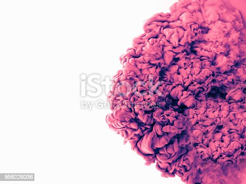 637797672istockphoto Color drop in water, photographed in motion. Abstract swirling. Cloud of silky bulb under water isolated on white background. Pink paint 958226036