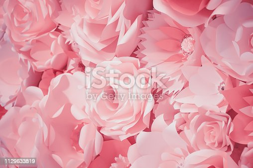 istock Color filter effect in pink of a 3D paper flower wall, decor idea or backdrop for weddings, baby shower, birthday or tea parties 1129633819