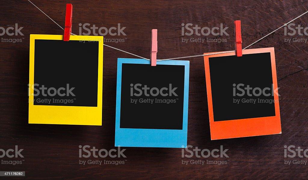 Color frames on a clothesline stock photo
