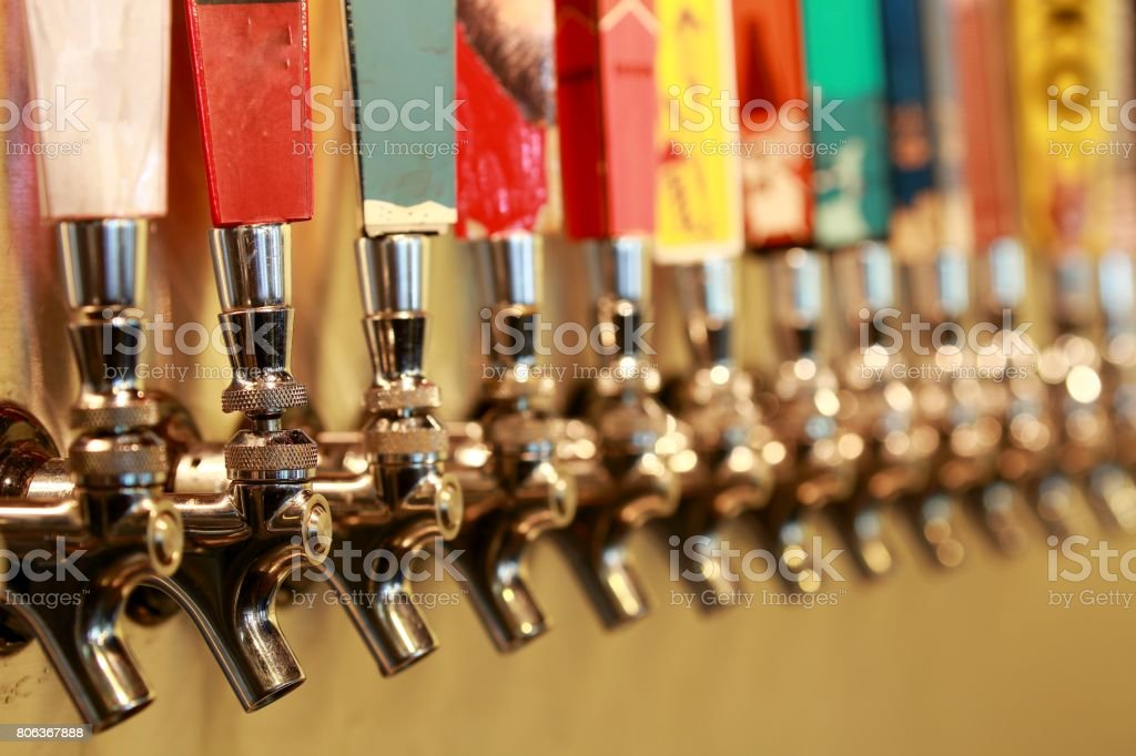 color full beer taps stock photo