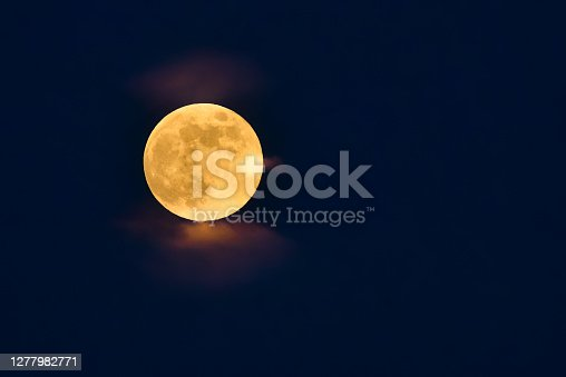 istock color full moon over beautiful summer landscape 1277982771