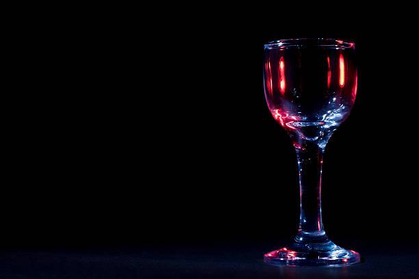 Color glares on wine glass stock photo