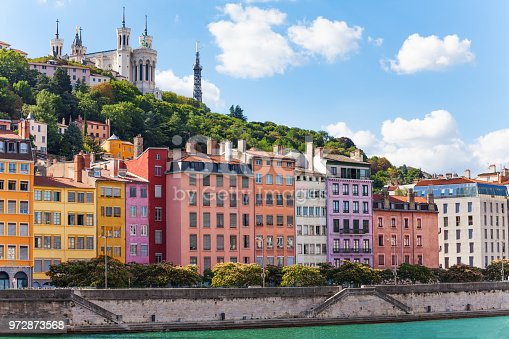 Scenic view of St. Georges district of old Lyon with its color houses and Basilica of Notre-Dame de Fourviere on the background