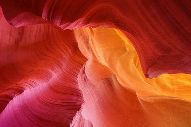 color hues of stone in antelope canyon - zandsteen stockfoto's en -beelden