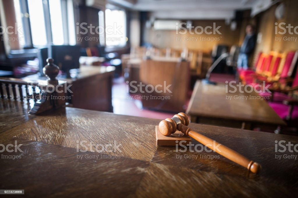 Color image of a hammer in a courtroom. stock photo