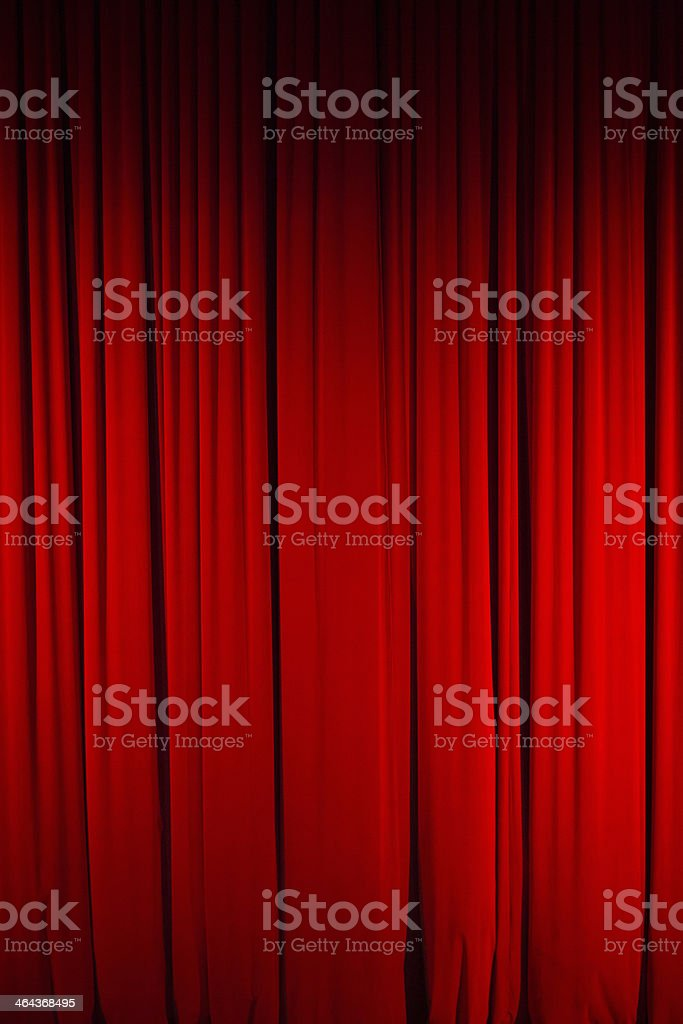 Color Image of Closed, Red Stage Curtain Color, full frame image of a closed stage curtain, marking the beginning/end of a performance. Backgrounds Stock Photo