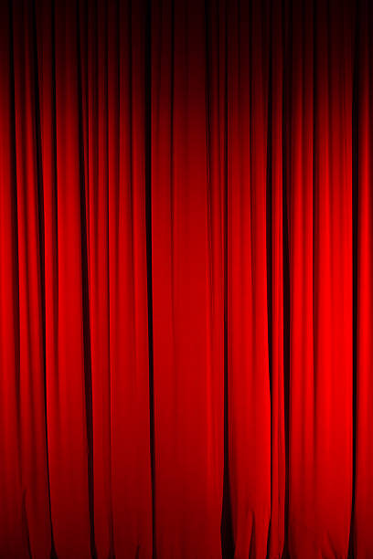 Color Image of Closed, Red Stage Curtain stock photo