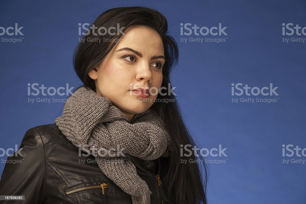 color image of girl in leather jacket with scarf stock photo
