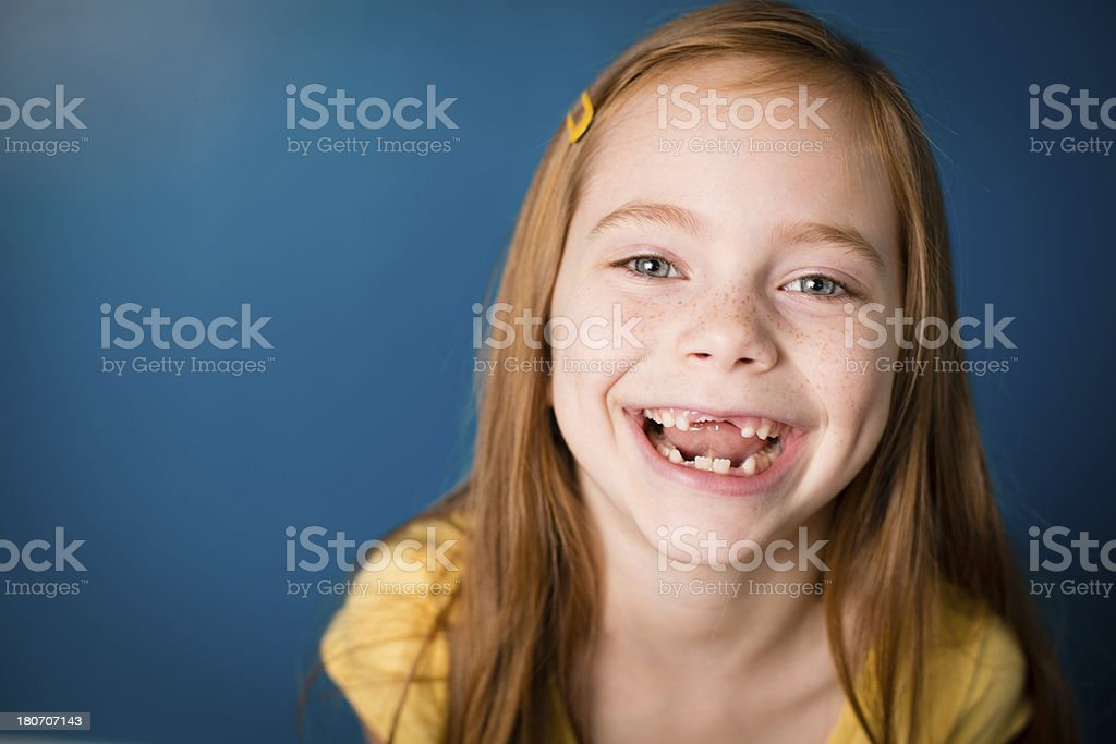 Color Image of Laughing Little Girl With Red Hair stock photo