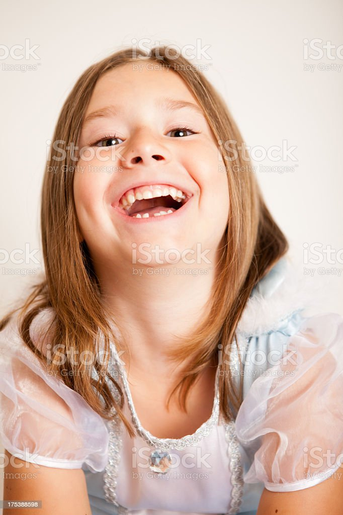 Color Image of Laughing Young Girl Dressed in Princess Dress stock photo