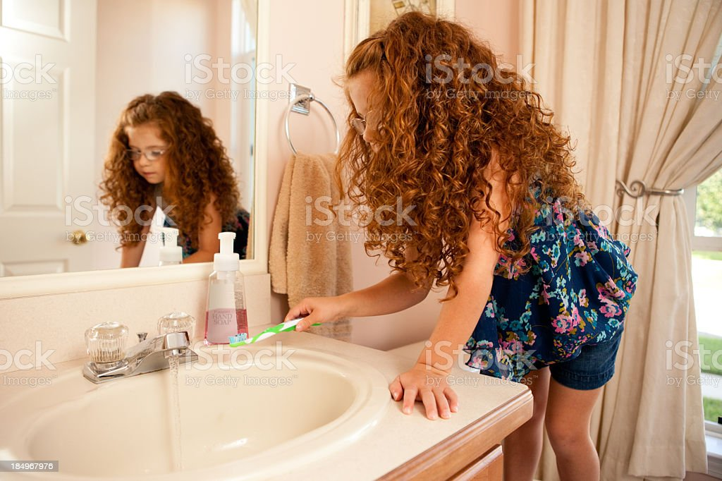 Color Image of Little Girl Brushing Her Teeth royalty-free stock photo