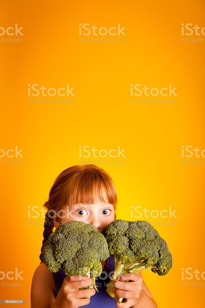 Color Image of Little Girl Holding Broccoli,With Copy Space royalty-free stock photo