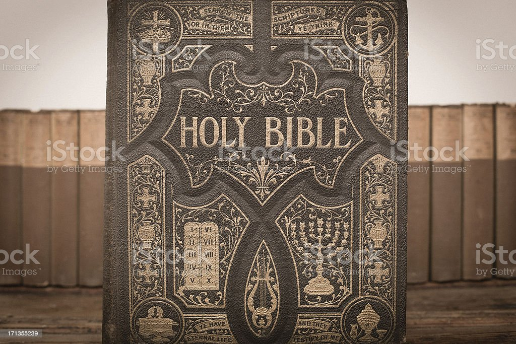 Color Image of Old, Ornate Holy Bible and Vintage Books royalty-free stock photo
