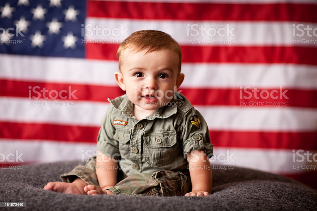 Color Image of Patriotic Baby Boy with American Flag Background royalty-free stock photo