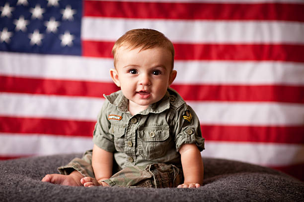 Color Image of Patriotic Baby Boy with American Flag Background stock photo
