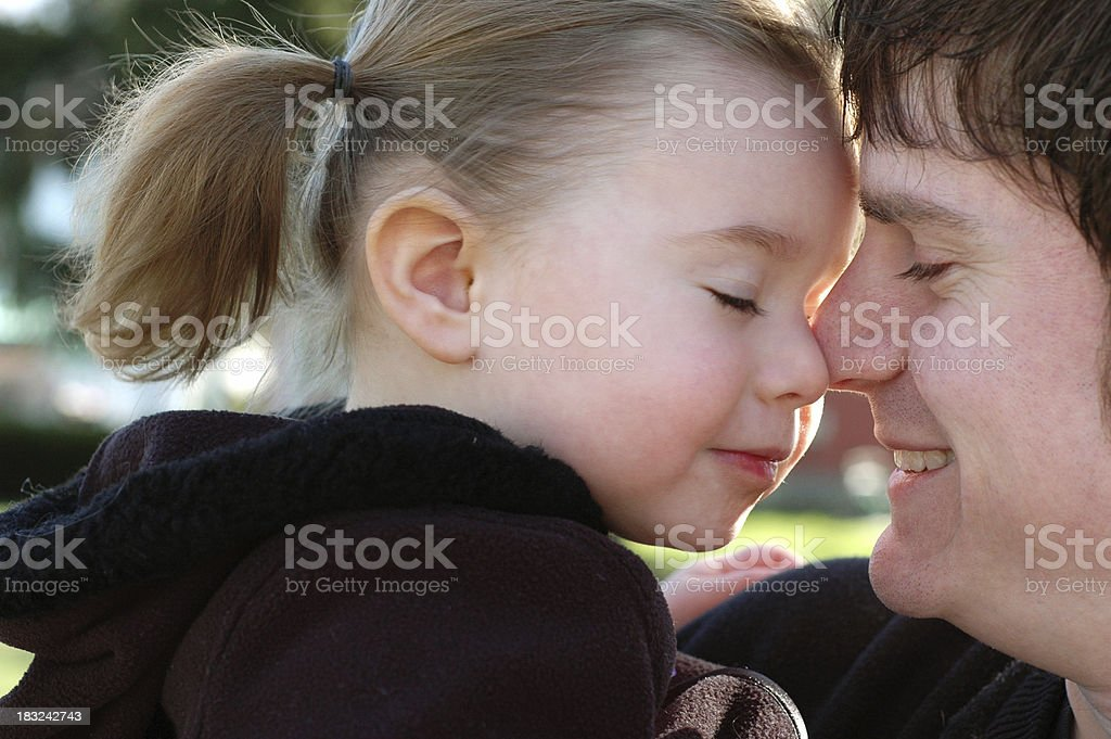 Color Image of Precious Moment Between Daughter and Daddy royalty-free stock photo