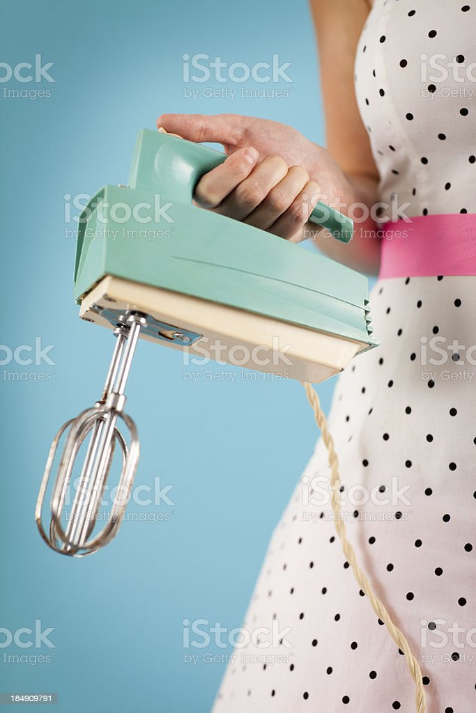 Color Image of Retro Gal Holding a Vintage Electric Mixer royalty-free stock photo