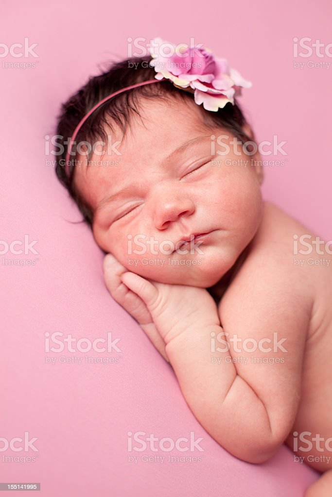 Color Image of Sleeping Newborn Baby Girl on Pink Background royalty-free stock photo