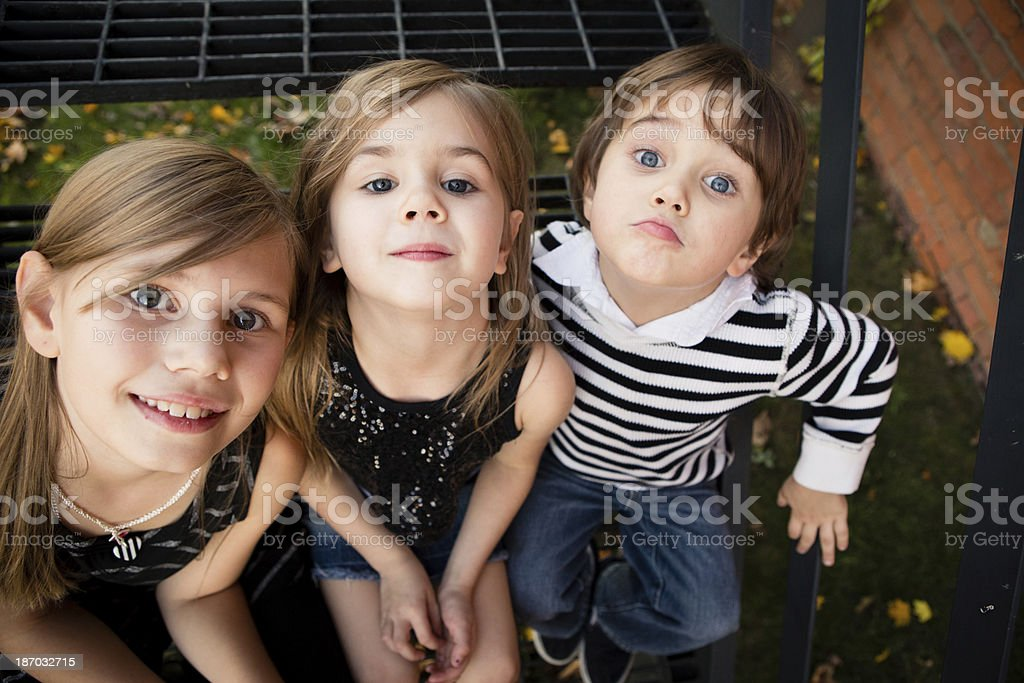 Color Image of Two Sisters and Little Brother Acting Silly royalty-free stock photo