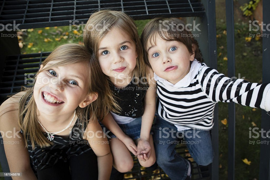 Color Image of Two Sisters and Their Little Brother royalty-free stock photo