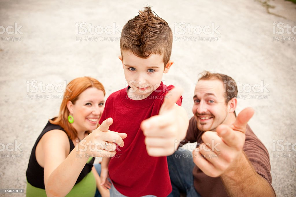 Color Image, Young Family of Three Giving Thumbs Up Sign stock photo