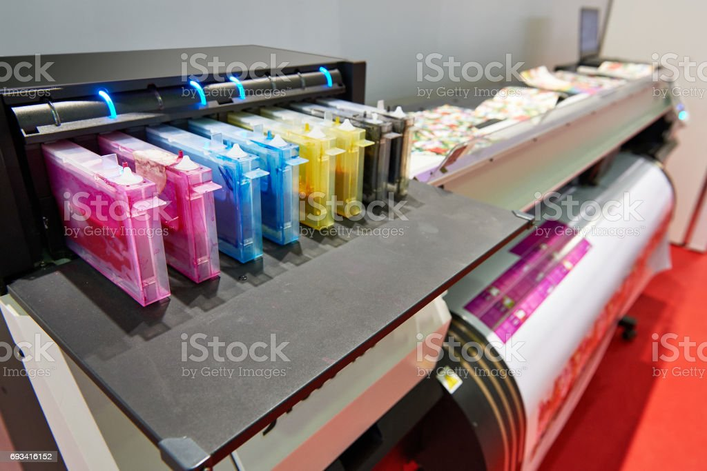 Color ink cartridge in the inkjet plotter stock photo