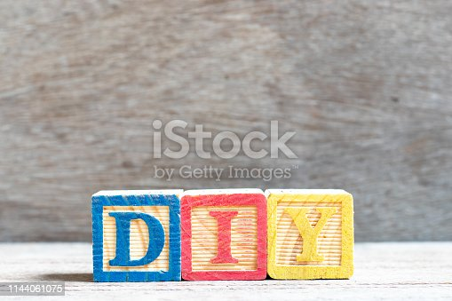 istock Color letter block in word DIY (abbreviation of do it yourself) on wood background 1144061075