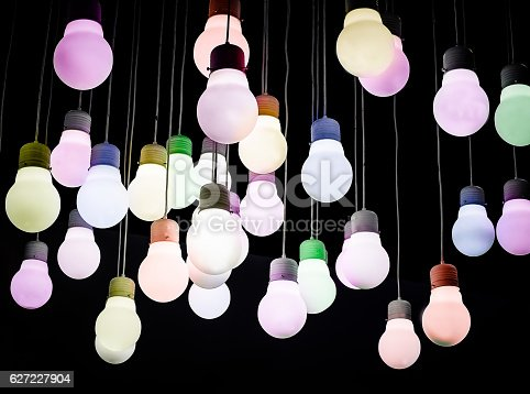 istock Color lighting ball hanging from the ceiling on the black background 627227904