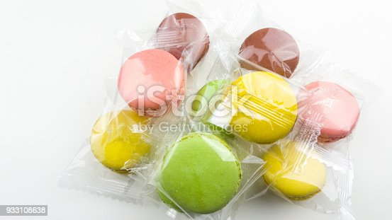 istock Color macaroons or macaron in transparent package close up. 933108638
