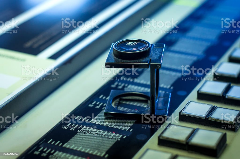 Color management in printing process with magnifying glass stock photo