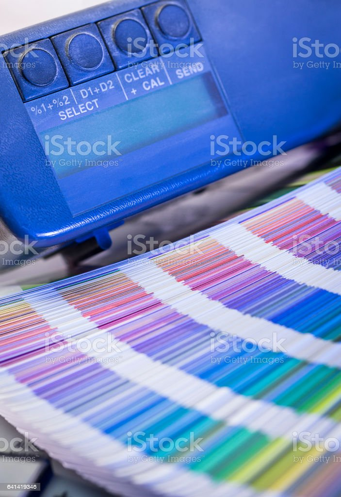 Color management process with color swatches and densitometer stock photo