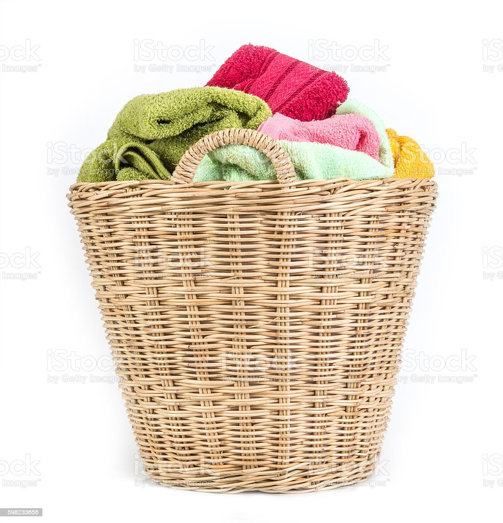 color mix  towel in wicker baskets on white background foto royalty-free