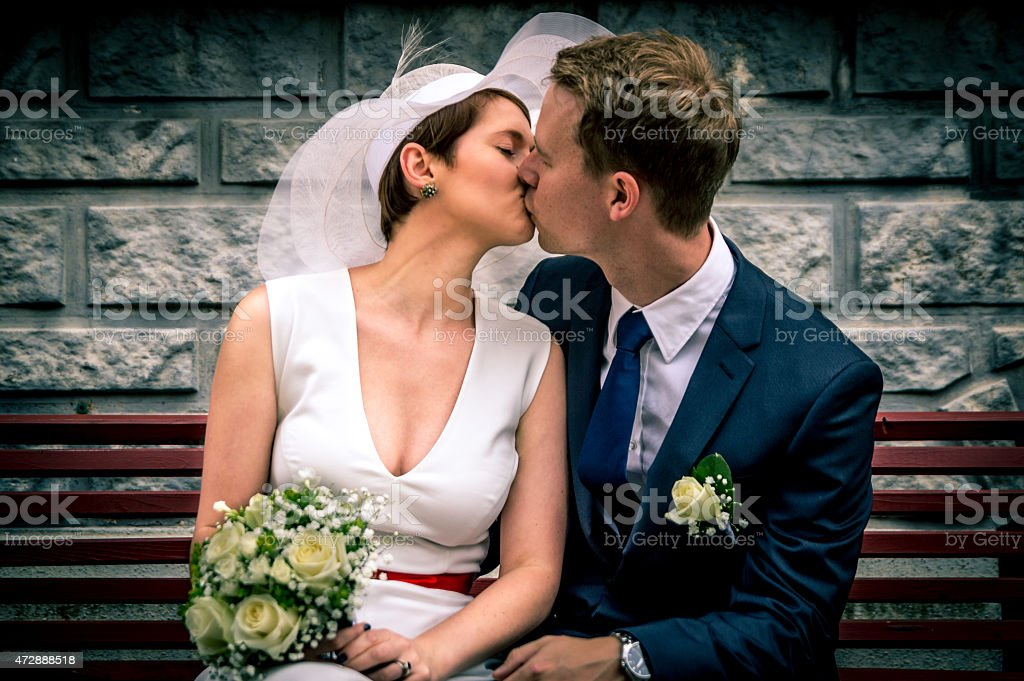 Color Newlyweds Kissing stock photo