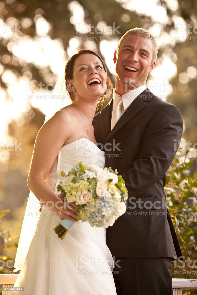 Color Newlyweds Laughing Together On Country House Porch Wooded Background stock photo
