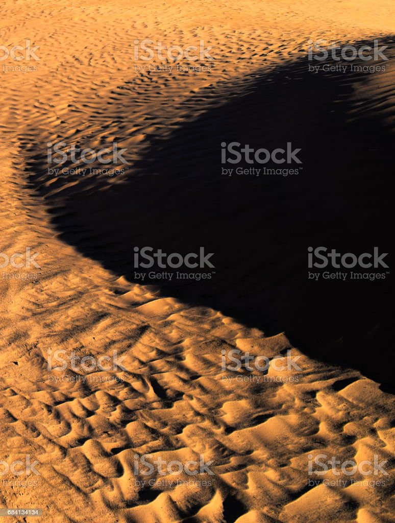 Color of sunset on the desert surface. Natural texture and background of the desert. Sand patterns zbiór zdjęć royalty-free