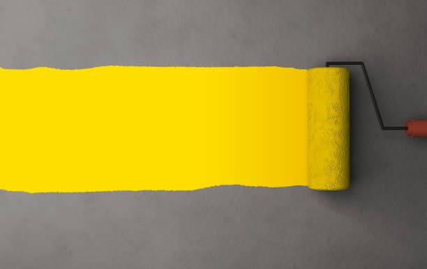 pintura del cepillo del rodillo - amarillo color fotografías e imágenes de stock