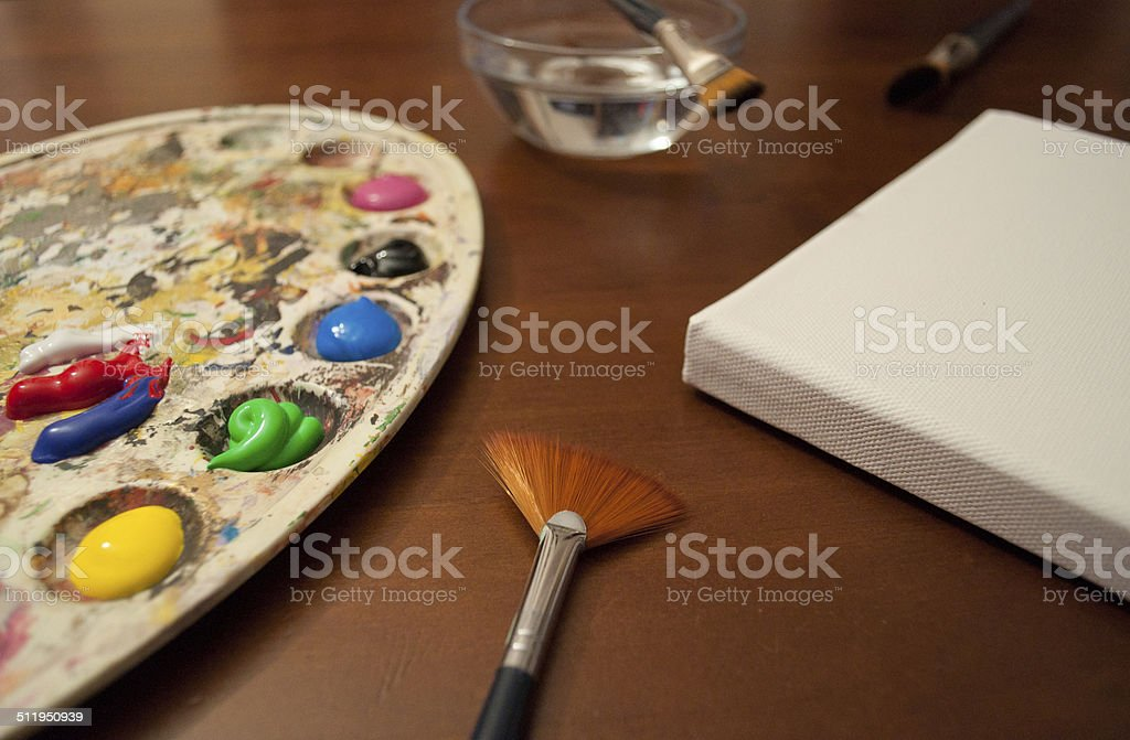 Color palette, canvas and brushes stock photo