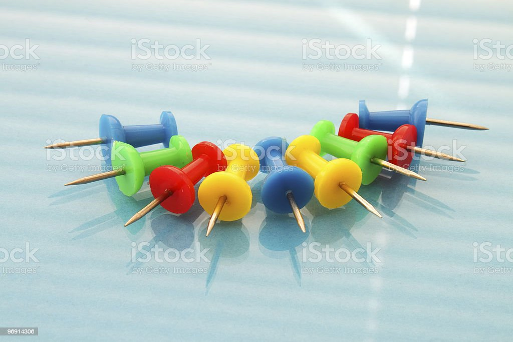 Color paper clips on a blue background royalty-free stock photo